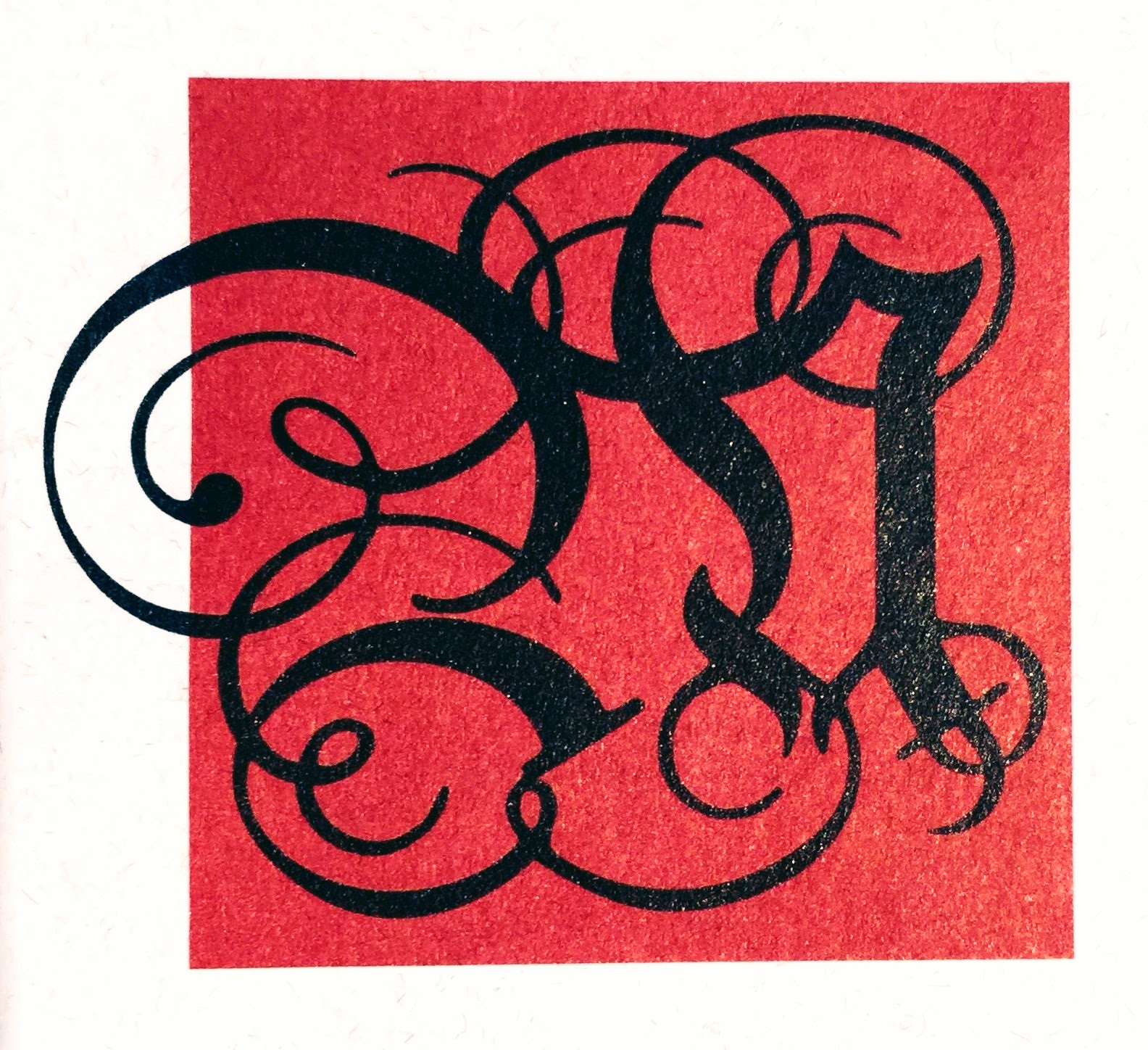 Verschnörkeltes M auf Rot